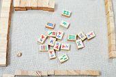 Playing Mahjong Board Game On Textile Table