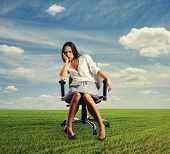doleful businesswoman sitting on the office chair at outdoors