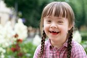 stock photo of playgroup  - Portrait of beautiful young girl smiling in park - JPG