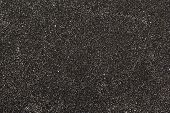 dry and black fine sand as background