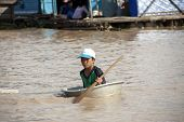 TONLE SAP LAKE, CAMBODIA - CIRCA APRIL 2012: Cambodian boy. Tonle Sap Lake.