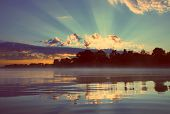 beautiful reflection sunrise on river - vintage retro style