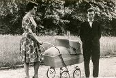 GERMANY, CIRCA FIFTIES - Vintage photo of parents with a baby in pram