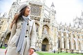 stock photo of church-of-england  - Westminster Abbey church London with young woman professional or tourist - JPG