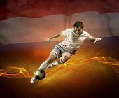 Abstract waves aroun soccer player on the national flag of Nederlands background