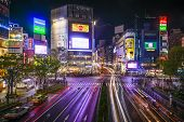 TOKYO, JAPAN - MARCH 30, 2014: Shibuya Ward at Shibuya crossing is one of Tokyo's major nightlife and fashion centers.
