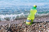 Fanta Bottle On The Beach