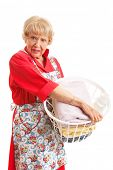 Senior woman hates doing laundry.  Isolated on white.
