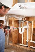 Construction plumber instaling a sink in a new building or renovation.