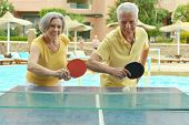 pic of ping pong  - Elderly couple playing ping pong at hotel yard - JPG
