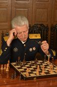 Military mature general playing chess