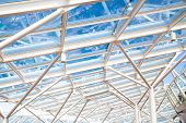 Glass Atrium Roof Supported By White Steel