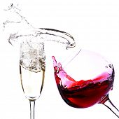 Two glasses with red wine and champagne, isolated on white