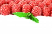 Ripe sweet raspberries isolated on white