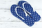 Color flip-flops on wooden background