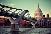 St Paul's cathedral in London and bridge over Thames River.