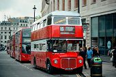 LONDON, UK - SEP 27: Vintage red bus in street on September 27, 2013 in London, UK. London is the wo