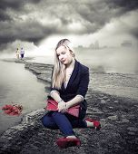 pic of broken heart flower  - Sad female sitting by the sea and looking on roses in water - JPG