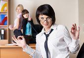 Attractive businesswoman with ok gesture