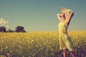 Beautiful girl enjoying the summer sun in the field.