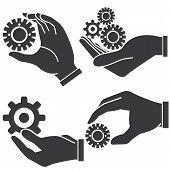hand holding gears