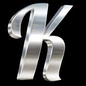 Letter K from chrome solid alphabet isolated on black