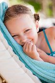 Portrait of charming little girl outdoors on beach vacation