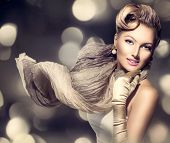 Glamourous Retro Woman Portrait. Beauty Glamour Lady with long blowing scarf. Golden gloves. Vintage