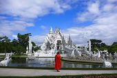 Buddhist Monk And White Temple.