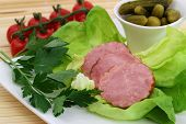 Traditional Polish smoked sausage on lettuce leaves