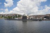 Naval Submarine Moored In Large River