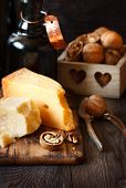 stock photo of nutcracker  - Delicious cheese, balsamic and walnuts with nutcracker.