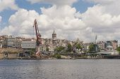 foto of derelict  - Old abandoned derelict dockyards by large river in Istanbul city - JPG