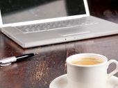 Modern Laptop With A Cup Of Coffee Next To It