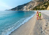 Children On Myrtos Beach (greece,  Kefalonia, Ionian Sea).