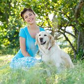 Cute girl in blue dress with adorable dog
