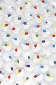 Capsule pills in plastic cups