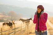 picture of horse girl  - beautiful young woman at horse farm in the cold winter morning - JPG