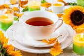 Cup of tea with autumn decor