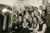 GERMANY, CIRCA FORTIES - Vintage photo of group of people during a family party