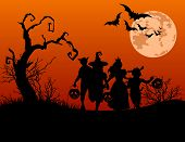 stock photo of happy halloween  - Halloween background with silhouettes of children trick or treating in Halloween costume - JPG