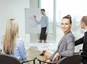 business and office concept - smiling businesswoman with team in office