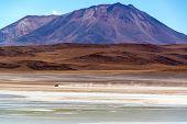 Suv Driving Across Desert