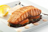 Salmon Steak with Baked Vegetables, White Sauce and Lemon