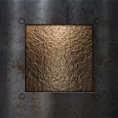 Gold chrome metal textured background with a grunge metallic frame