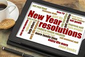 New Year goals or resolutions - a word cloud on a digital tablet with cup of coffee