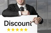 Businessman Pointing On Sign Discount