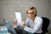 Blonde Businesswoman Reading Letter