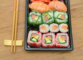 Japanese Sushi And Rolls Close Up On Wooden Background