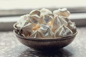 White Meringue In Silver Plate